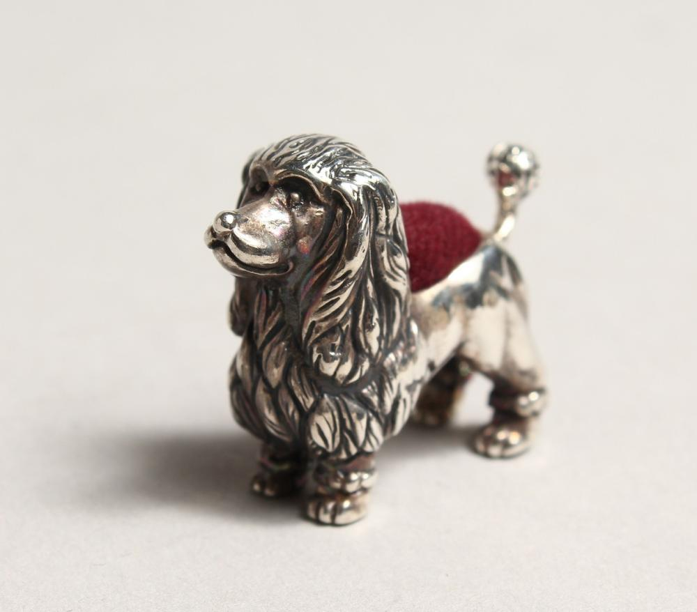 A NOVELTY SILVER POODLE PIN CUSHION