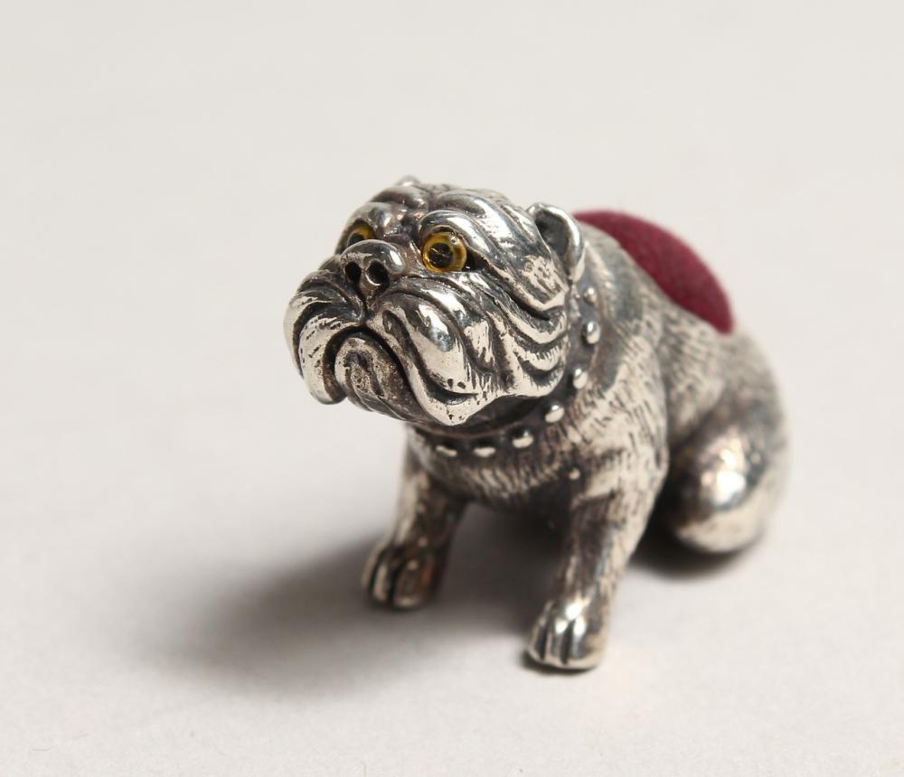 A NOVELTY SILVER BULL DOG PIN CUSHION