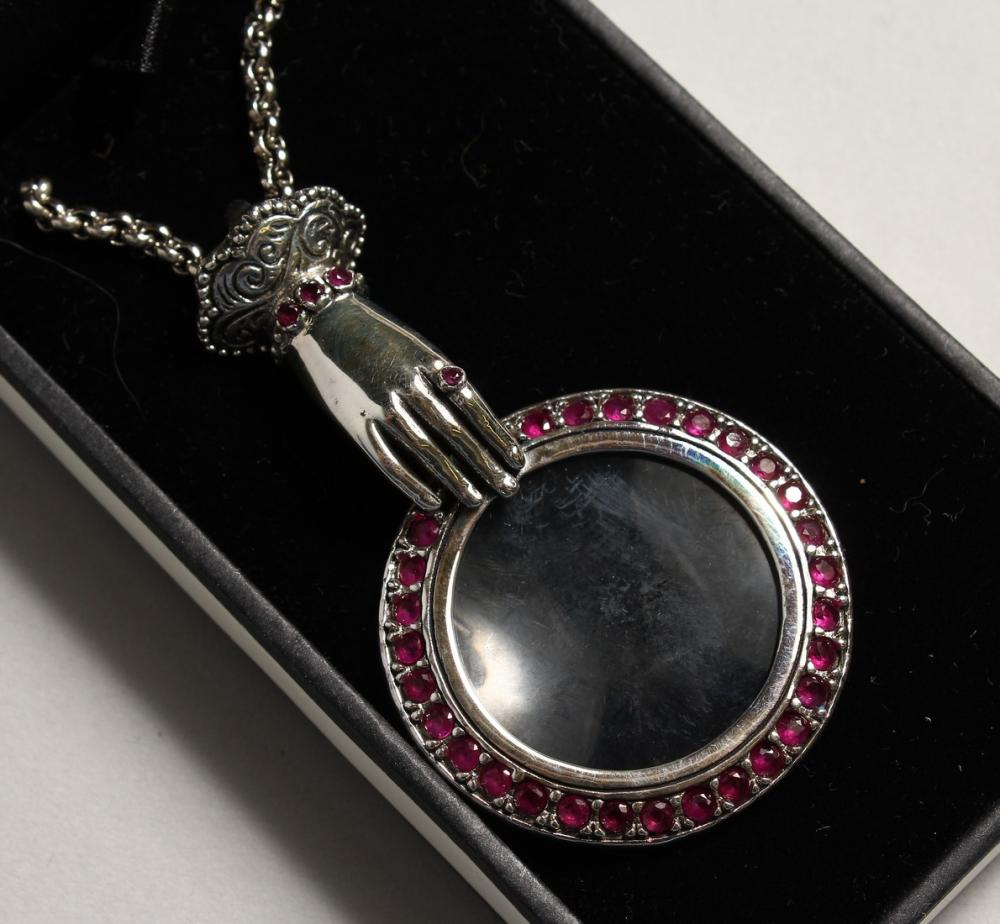 A SILVER RUBY HAND MAGNIFYING GLASS.