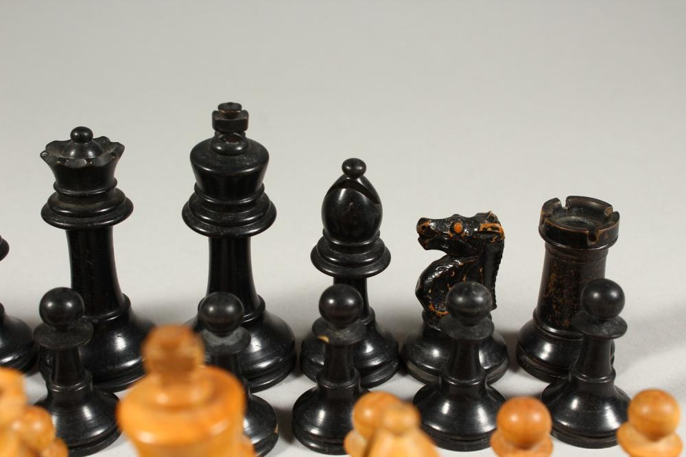A BOXWOOD CHESS SET in a box