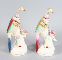 TWO 19TH CENTURY ENGLISH PORCELAIN BIRD QUILL HOLDERS, CIRCA. 1850. <br>7ins high.
