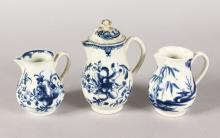 THREE VARIOUS WORCESTER BLUE AND WHITE JUGS, one with a lid.