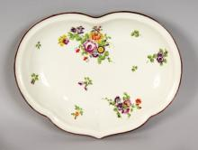 A GOOD WORCESTER CRESCENT SHAPED DISH, painted with flowers. <br>11ins wide.