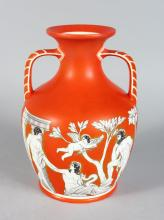 A LARGE ORANGE PORCELAIN PORTLAND VASE with printed design. <br>10ins high.