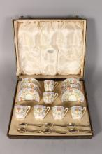 A ROYAL WORCESTER FINE CASED COFFEE SET OF CUPS AND SAUCERS and six silver spoons date code for 1933.