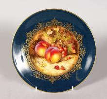 A ROYAL WORCESTER PLATE painted with a powder blue and gilt border, the centre painted with fruit by R. Sebright, date code for 1923.