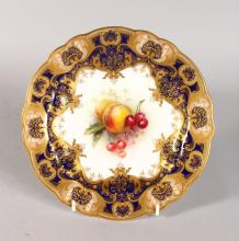 A ROYAL WORCESTER FINE PLATE with cobalt blue border and art nouveau style gilding, the centre painted with fruit by R. Sebright, signed, date code for 1910.
