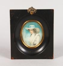 A FRAMED OVAL PORTRAIT OF A YOUNG LADY. <br>3ins x 2.25ins.