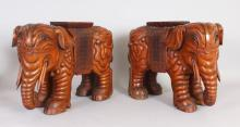 A PAIR OF EASTERN CARVED WOOD ELEPHANT SEATS. <br>1ft 6ins long x 1ft 1ins high.