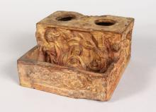 AN ITALIAN (PROBABLY FLORENTINE 17TH CENTURY) TERRACOTTA POTTERY INKSTAND, with relief