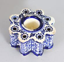 AN ISLAMIC BLUE AND WHITE PORCELAIN INKWELL.