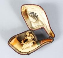 A MEERSCHAUM PIPE, young lady in a leather case.