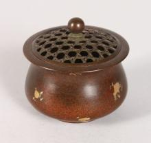 A SMALL CHINESE GOLD SPLASH CIRCULAR BRONZE CENSER AND COVER. <br>2.5ins diameter.