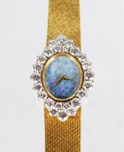 A LADIES 18CT YELLOW GOLD DIAMOND SET COCKTAIL WATCH by DE LAVEAU, SWISS, with lapis face and set with 24 diamonds, No. 16017.