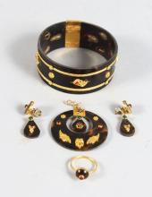 A TORTOISESHELL GOLD MOUNTED SUITE OF JEWELLERY, BRACELET, PENDANT, RING AND EARRINGS.