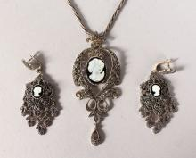 A SILVER MARCASITE CAMEO NECKLACE AND EARRINGS.