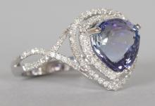 A 14K WHITE GOLD AND DIAMOND RING SET WITH A PEAR CUT TANZANITE approx. 4CT, diamonds approx. 0.75CT total weight. <br>