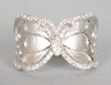 AN UNUSUAL 18CT WHITE GOLD AND DIAMOND RING, in the form of a BUTTERFLY, set with .5CTs diamonds. <br>