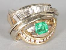 A GOOD 14CT YELLOW GOLD DESIGNER RING, set with princess cut emerald baguette diamonds to the crossover. <br>