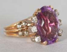 A SUPERB LARGE 7CT AMETHYST AND DIAMOND CLUSTER RING. <br>