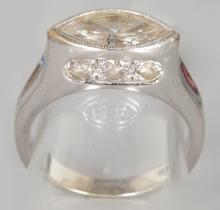 AN UNUSUAL 18CT WHITE GOLD DIAMOND MARQUISE RING of 1.5CT with diamond shoulders. <br>