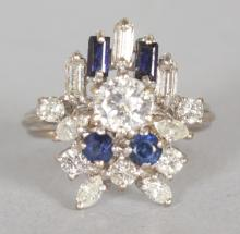 A GOOD WHITE GOLD ART DECO STYLE SAPPHIRE AND DIAMOND CLUSTER RING. <br>