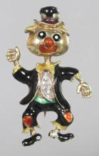 AN AMUSING 18CT YELLOW GOLD AND ENAMEL DANCING FIGURE BROOCH, set with diamonds. <br>