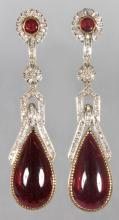 A SUPERB PAIR OF DIAMOND AND GARNET DROP EARRINGS, set in yellow gold.