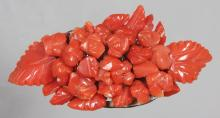 A 19TH CENTURY CARVED CORAL BROOCH. <br>