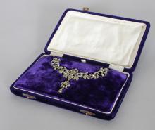 A GOOD ANTIQUE CHRYSOLITE AND DIAMOND NECKLACE, in original blue velvet box. <br>