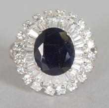 A LARGE SAPPHIRE AND BRILLIANT SET CLUSTER RING, set in silver. <br>