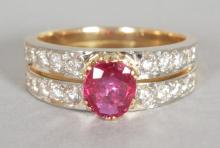 A SUPERB RUBY AND DIAMOND RING, central ruby 1.68CTs and two rows of diamonds in yellow gold. <br>