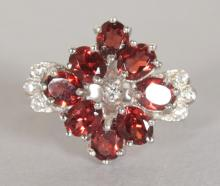 A SILVER, RUBY AND BRILLIANT SET CLUSTER RING. <br>