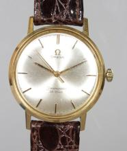 A GENTLEMAN'S 18CT GOLD OMEGA SEAMASTER WRIST WATCH with leather strap. <br>