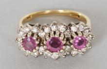 A GOOD 18CT GOLD, RUBY AND DIAMOND TRIPLE CLUSTER RING. <br>