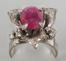 A RUBY AND DIAMOND FANCY PIERCED RING with large ruby and smaller diamonds. <br>