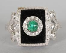 AN ART DECO 14CT WHITE GOLD, DIAMOND AND ONYX RING. <br>