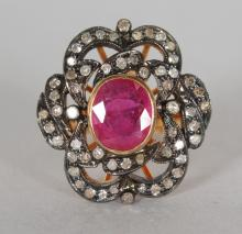 A 14CT GOLD AND SILVER SET RUBY AND OLD CUT DIAMOND RING. <br>