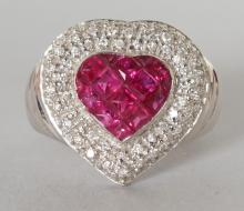 A GOOD 18CT WHITE GOLD, RUBY AND DIAMOND HEART SHAPED RING. <br>