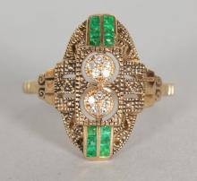 A 9CT YELLOW GOLD, EMERALD AND DIAMOND RING. <br>