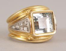A GOOD 18CT YELLOW GOLD AQUAMARINE AND DIAMOND RING. <br>