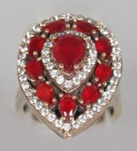 A SILVER, RUBY AND BRILLIANT SET TEARDROP RING. <br>