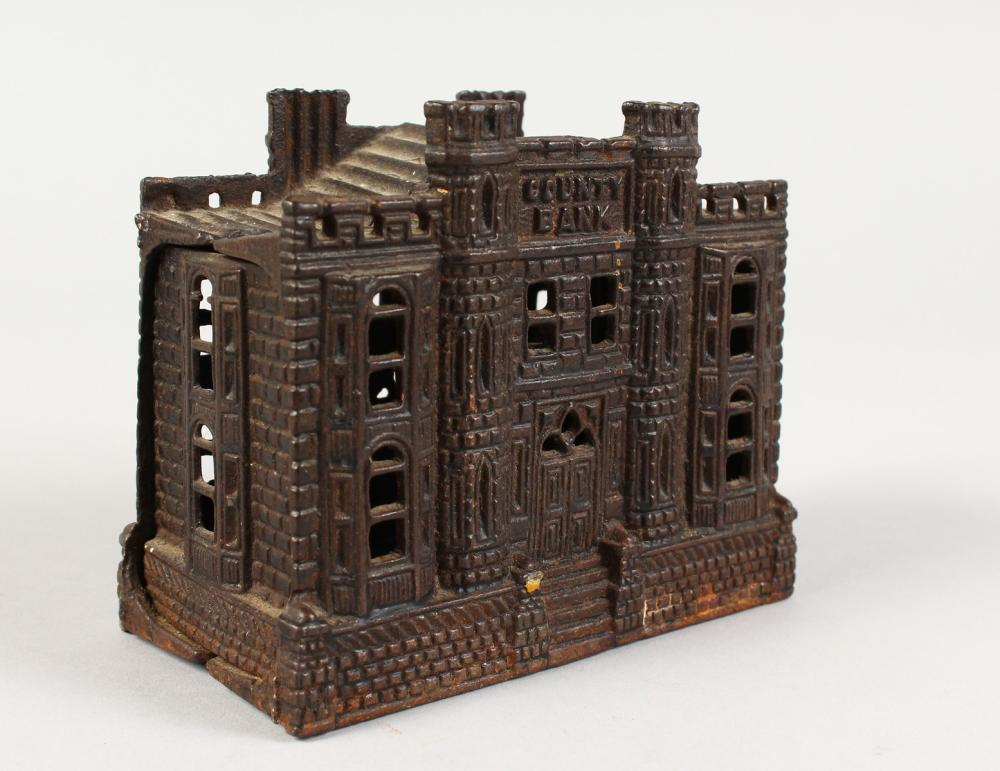 A VICTORIAN CAST IRON MONEY BOX, cast in the form of a caste