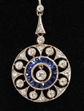 A LOVELY DIAMOND AND SAPPHIRE CIRCULAR PENDANT on a yellow gold chain set with diamonds.