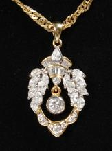 A LOVELY 18CT YELLOW GOLD AND DIAMOND PENDANT and A CHAIN.