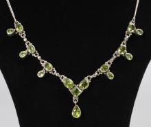 A SILVER NECKLACE set with yellow stones.