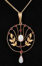 AN EDWARDIAN 15CT YELLOW GOLD, OPAL AND RUBY SET PENDANT on a chain.
