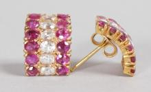 A PAIR OF YELLOW GOLD, RUBY AND DIAMOND HOOP EARRINGS.