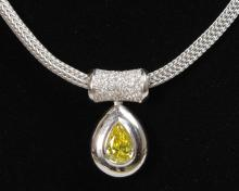 A SUPERB YELLOW DIAMOND TEARDROP PENDANT on an 18ct white gold necklace with diamonds.