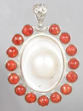 A MOTHER-OF-PEARL AND CORAL PENDANT.